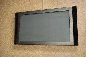 Hvordan du installerer et TV-beslag på beton