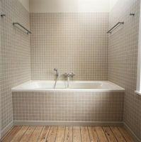 Sådan reparation fliser på et badekar