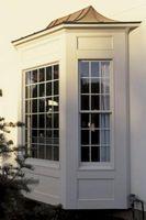 Hvordan man laver en gardinstang for en bue vindue