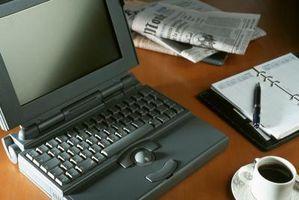 Hvordan til at bore huller gennem dit skrivebord til netkabler
